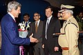 Indian police officer salutes Secretary Kerry upon arrival in Ahmedabad for Vibrant Gujarat Summit.jpg