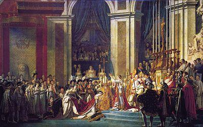 Die Krönung in Notre Dame (1804). Napoleon, der sich zuvor selbst gekrönt hat, setzt seiner Gemahlin Joséphine die Krone auf. Rechts von Napoleon sitzt Papst PiusVII. (Gemälde von Jacques-Louis David) Quelle: wikipedia