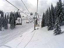 Skiers riding a chairlift