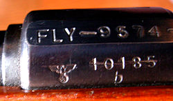 The emblem of Nazi germany, eagle with swastika, is still visible on many of the rifles that were used by the Norwegian military