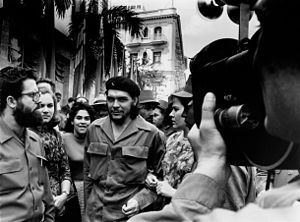 Alberto Korda - Alberto Korda taking a picture of Che Guevara, with arms linked to his wife Aleida March.
