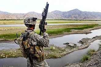 Helmet camera - US soldier in Afghanistan with a personal helmet camera, 2010.