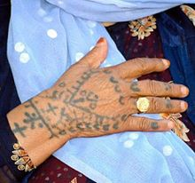 A woman's tattooed right hand