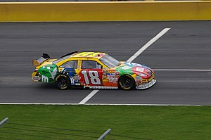 Shopping Sports Motorsports Auto Racing Tools   Team on English  Kyle Busch Driving The 18 Car On Pit Road In The 2009 Coca