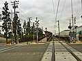 LACMTA Gold Line Duarte Station, with departing train in distance.jpg