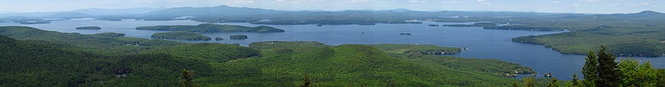 Panoramic view of Lake Winnipesaukee looking north from the summit of Mount Major. The entrance to Alton Bay lies at the right edge of the picture. The large island near the center-left is Rattlesnake Island, while the three islands in front of it (l-r) are Sleeper's Island, Cub Island, and Treasure Island. The island to the left of Rattlesnake Island is Diamond Island. Wolfeboro Bay is visible at the far side of the lake near the center-right of the image.