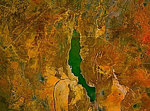 Lake Turkana - Satellite image of Lake Turkana, distinguishable from its jade color. The Omo River enters at the top. The river visible on the lower left is the Turkwel, which has been dammed for hydroelectric power.