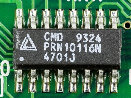 "Small-outline integrated circuit. This package has 16 ""gull wing"" leads protruding from the two long sides and a lead spacing of 0.050 inches. Laptop Acrobat Model NBD 486C, Type DXh2 - California Micro Devices CMD 9324 on motherboard-9749.jpg"
