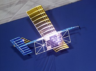 Wireless power transfer - A laser beam centered on a panel of photovoltaic cells provides enough power to a lightweight model airplane for it to fly.