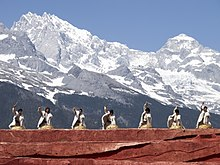 Lijiang Yunnan China-Naxi-people-with-drums-01.jpg