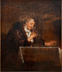 Vieille femme mangeant au coin du feu
