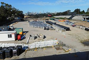 Lilyfield, New South Wales - Construction of a light rail maintenance facility on the site of the Rozelle Rail Yards in 2017. The City West Link can be seen to the right. Lilyfield light rail stop is located below that road. Lilyfield's fairly close proximity to the Sydney CBD can be judged by the visibility of the Sydney CBD skyline in the background.