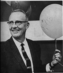 Photo of Luis Alvarez with balloons.