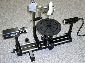 Surface tension can be measured using the pendant drop method on a goniometer.