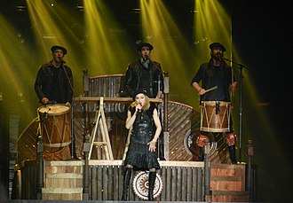 "Open Your Heart (Madonna song) - Madonna, flanked by the Kalakan Trio, performs an acoustic version of ""Open Your Heart"" during The MDNA Tour in 2012."