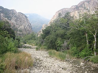 Malibu Creek - Malibu Creek, dry river bed,  with the Goat Buttes in the background