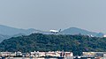 Mandarin Airlines Embraer 190 B-16822 Flight over Gounguan Mountain, Neihu District, Taipei 20150104.jpg