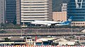 Mandarin Airlines Embraer 190 B-16822 on Final Approach at Taipei Songshan Airport 20150104b.jpg
