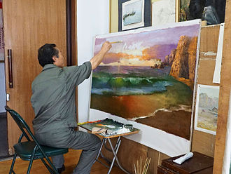 Mansudae Art Studio - An artist painting at Mansudae Art Studio