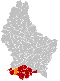 Map of Luxembourg with Sanem highlighted in orange, the district in dark grey, and the canton in dark red