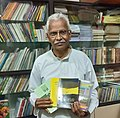 Marathi writer Sunilkumar Lawate with re-licensed books.jpg