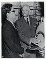 Mark Bortman inspects an iron lung with an unidentified man (12618197415).jpg