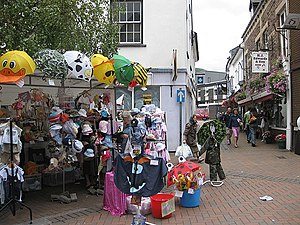 English: Market stall, High Cross Headgear and...