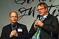 Martin Tenge, Propst Katholische Kirche, und Hans-Martin Heinemann, Stadtsuperintendent Landeskirche Hannover auf der Bühne zur Solidaritätstafel 2012 in der Georgstraße.jpg
