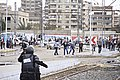 Men throwing rocks at police - protest Al-Azhar University Cairo 20-Dec-2013.jpg