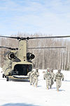 Michigan National Guard conducts cold weather sling load and howitzer live fire exercise 140228-Z-LE308-013.jpg