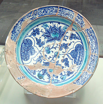 Slip (ceramics) - Miletus ware showing a red body covered by white slip, then painted in blue. End of 14th-early 15th century, Turkey.
