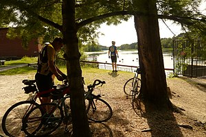 Mine Falls Park - Cyclists take a break at the 1886 Mine Falls Gatehouse in Mine Falls Park