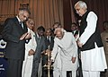 Mohd. Hamid Ansari lighting the lamp to inaugurate the Golden Jubilee celebrations of the Bar Council of Punjab & Haryana, in Chandigarh. The Governor of Punjab.jpg