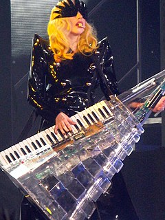 Keytar electronic keyboard supported by a strap around shoulders like a guitar