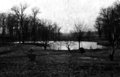 Monticello Seminary - West Campus - log cabin in distance.png