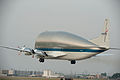 NASA's Super Guppy takes off from Ellington Field (JSC2012-E-097142).jpg