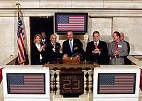 U.S. Secretary of Commerce Donald L. Evans rings the opening bell at the NYSE on April 23, 2003. Former chairman Richard Grasso is also in this picture.