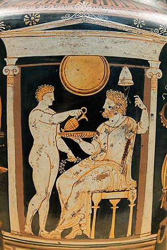 Patera - A youth pours a libation to the deceased within a naiskos, a scene that may also represent Ganymede serving Zeus (Apulian red-figure krater, 340–320 BC)