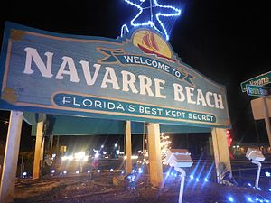 Navarre, Florida - The old Navarre Beach sign with Christmas decorations, a new one with a new town nickname was unveiled in June of 2017, the popularity of the old sign caused some of the first protests the town has seen