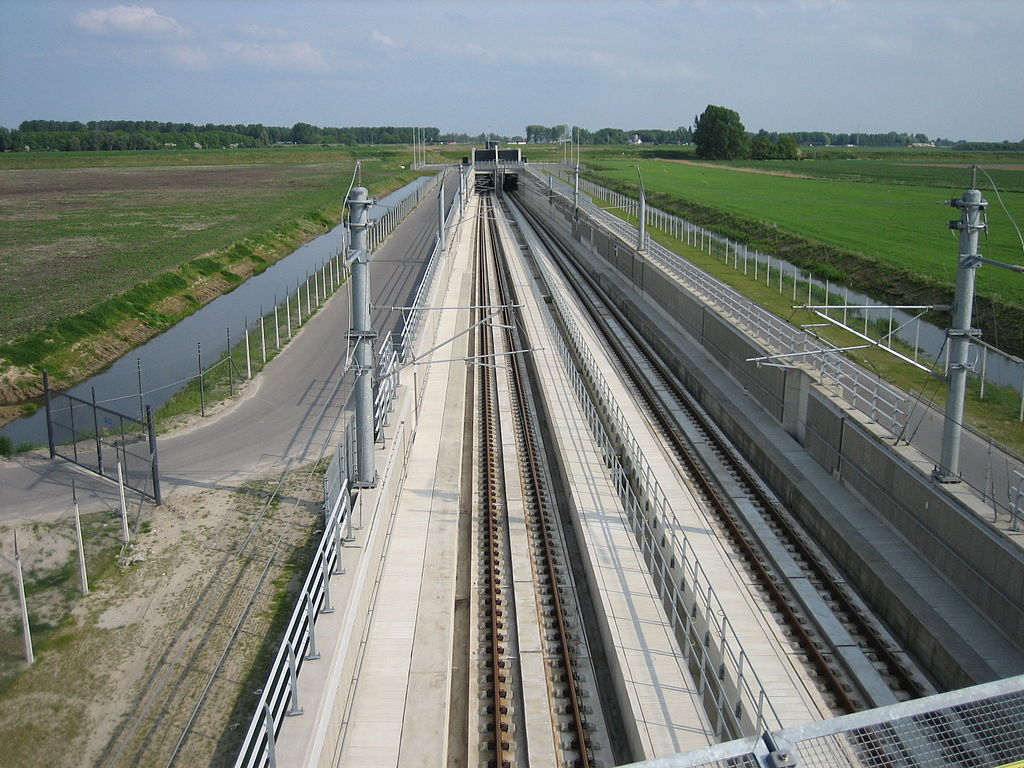 "Ballastless double track of the type ""Rheda 2000"" including concrecte slabs and ties/sleepers, rails, and drainage slits."