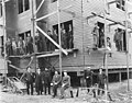 New courthouse under construction with carpenters and businessmen, Nome, July 24, 1908 (AL+CA 6602).jpg