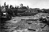 No. 2 Engineer Stores Depot of the Royal Engineers in Liphook - Part of the tractor park, 4 hours after 8 hours rain.jpg