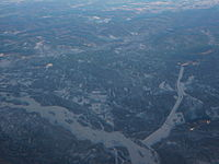 An aerial view of North Pole, looking north, with the Tanana River to the southwest of it