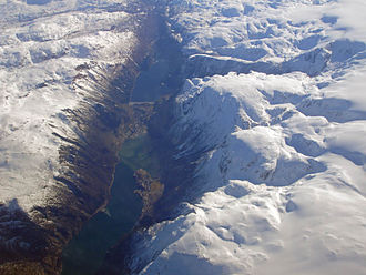 Fjord - Sørfjorden (Hardanger) with Sandvinvatnet and Odda valley can be clearly seen as continuation of the fjord. Odda sits on the isthmus. Folgefonna on the right hand.