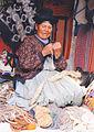 Old Indian female spinning on market Peru.jpg