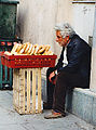 Old man with baked breads Greece.jpg