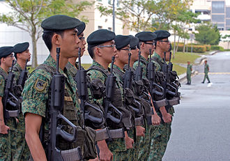 Goh Keng Swee - Infantry soldiers of the Singapore Army awaiting the arrival of the deputy commanding general of the Army National Guard, United States Army Pacific, for a joint training exercise in July 2009. Compulsory National Service was initiated by Goh when he was Singapore's first Minister for the Interior and Defence.