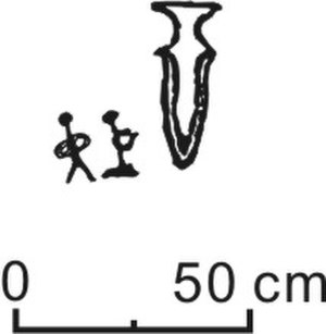 Prehistoric Korea - Representations of a dagger (right)and two human figures, one of which is kneeling (left), carved into the capstone of Megalithic Burial No. 5, Orim-dong, Yeosu, Korea.