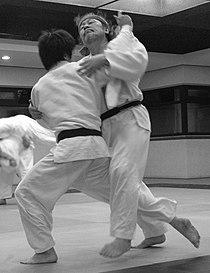 Judoka attempting Ōuchi-gari during randori.