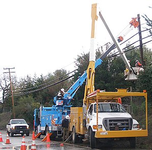 Lineworker - Linemen repairing electricity distribution lines that supply power to homes
